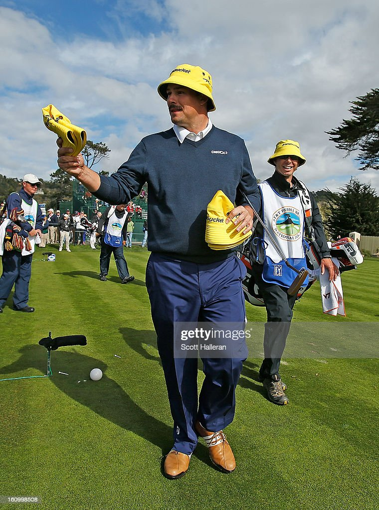 Johnson Wagner passes bucket hats out to fans on the 17th hole during the second round of the AT&T Pebble Beach National Pro-Am at Pebble Beach Golf Links on February 8, 2013 in Pebble Beach, California.