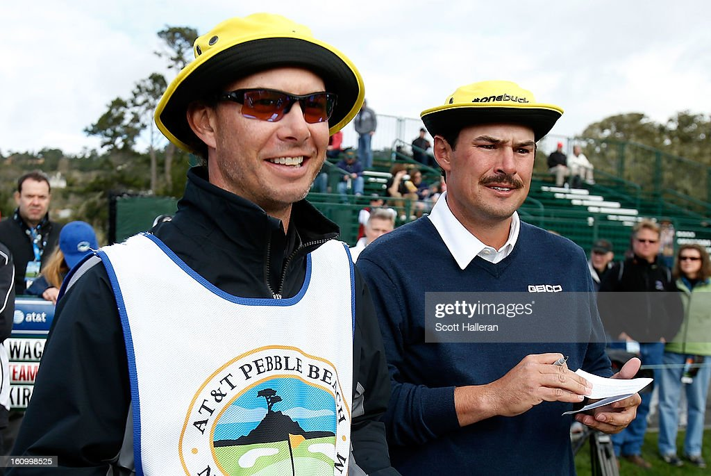 Johnson Wagner waits on the 17th hole with his caddie Matt Hauser during the second round of the AT&T Pebble Beach National Pro-Am at Pebble Beach Golf Links on February 8, 2013 in Pebble Beach, California.