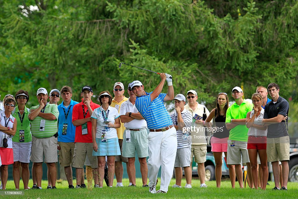 <a gi-track='captionPersonalityLinkClicked' href=/galleries/search?phrase=Johnson+Wagner&family=editorial&specificpeople=2130525 ng-click='$event.stopPropagation()'>Johnson Wagner</a> watches his second shot on the 12th hole during round two of the Greenbrier Classic at the Old White TPC on July 5, 2013 in White Sulphur Springs, West Virginia.