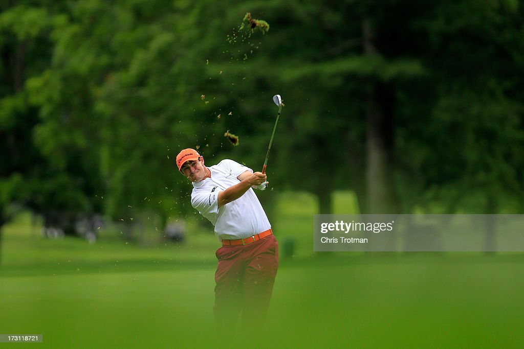 <a gi-track='captionPersonalityLinkClicked' href=/galleries/search?phrase=Johnson+Wagner&family=editorial&specificpeople=2130525 ng-click='$event.stopPropagation()'>Johnson Wagner</a> watches his second shot on the 5th hole during the final round of the Greenbrier Classic at the Old White TPC on July 7, 2013 in White Sulphur Springs, West Virginia.