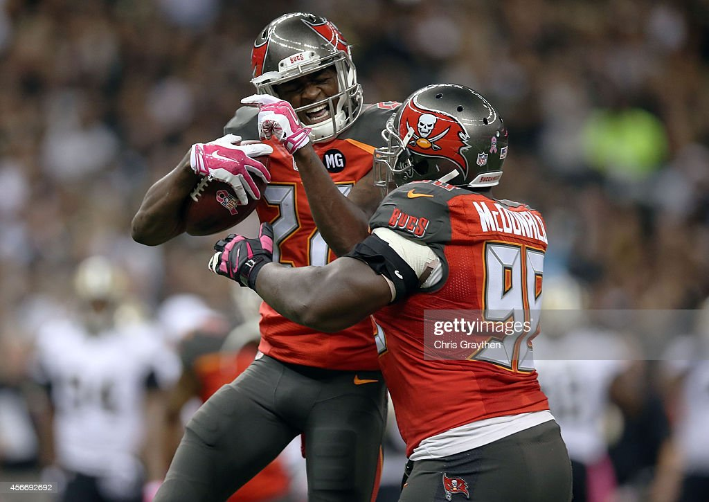 Johnthan Banks #27 of the Tampa Bay Buccaneers celebrates an interception with Clinton McDonald #98 during the second quarter of a game against the New Orleans Saints at the Mercedes-Benz Superdome on October 5, 2014 in New Orleans, Louisiana.