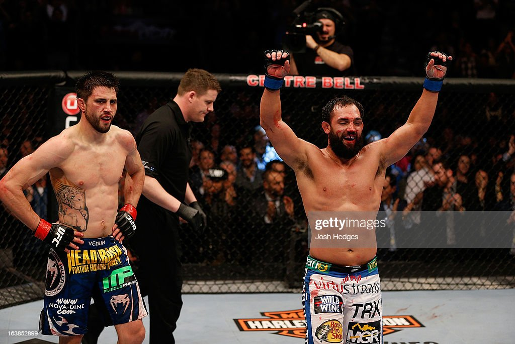 Johny Hendricks and Carlos Condit react after the conclusion of their welterweight bout during the UFC 158 event at Bell Centre on March 16 2013 in...