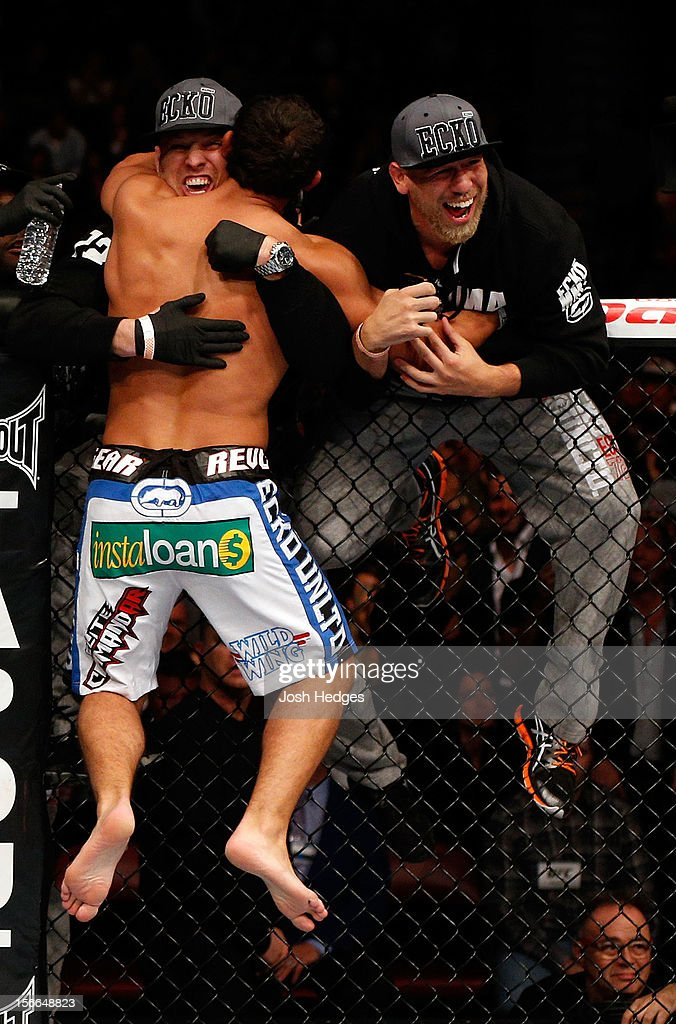 Johny Hendricks celebrates with his corner after knocking out Martin Kampmann with a left in the first round to win their welterweight bout during UFC 154 on November 17, 2012 at the Bell Centre in Montreal, Canada.