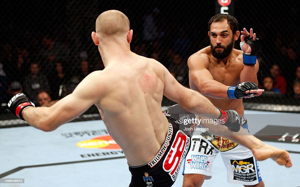 Johny Hendricks (R) fights against Martin Kampmann in their welterweight bout during UFC 154 on November 17, 2012 at the Bell Centre in Montreal, Canada.