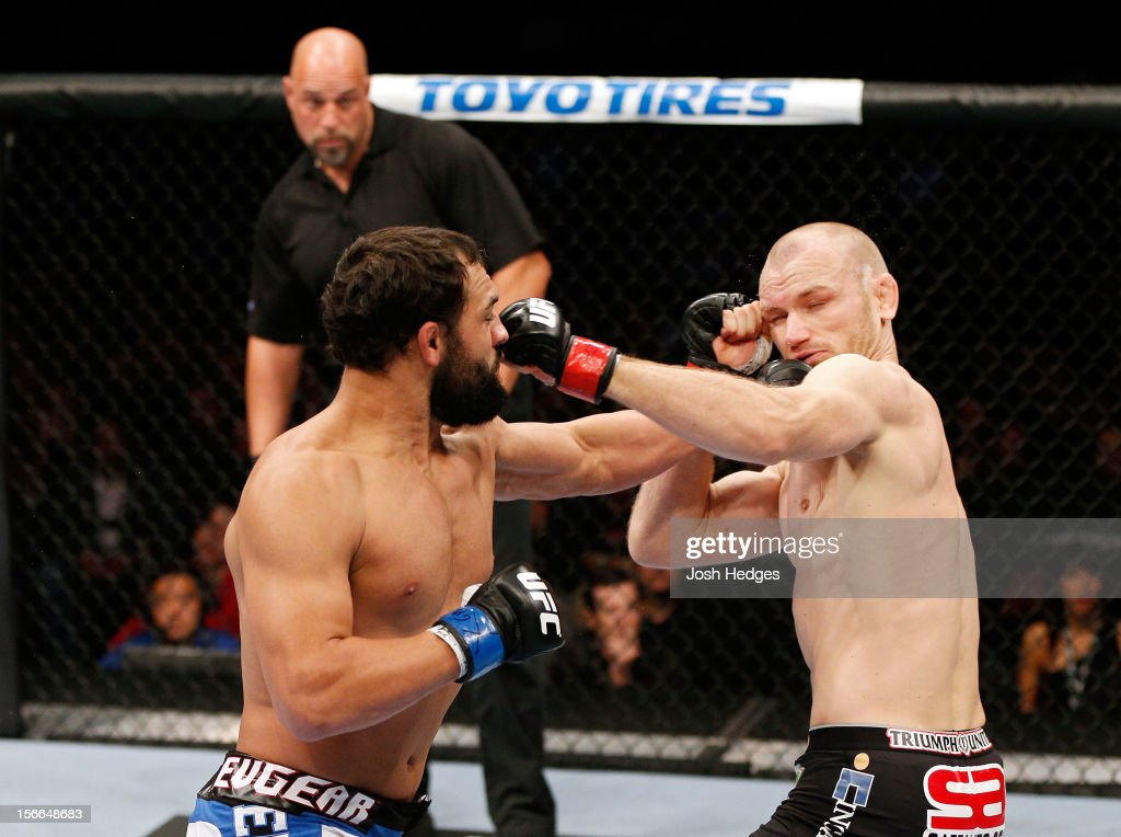 Johny Hendricks (L) knocks out <a gi-track='captionPersonalityLinkClicked' href=/galleries/search?phrase=Martin+Kampmann&family=editorial&specificpeople=5525013 ng-click='$event.stopPropagation()'>Martin Kampmann</a> with a left in the first round to win their welterweight bout during UFC 154 on November 17, 2012 at the Bell Centre in Montreal, Canada.