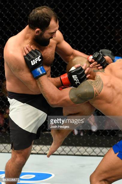 Johny Hendricks lands a knee to Hector Lombard of Cuba in their middleweight fight during the UFC Fight Night event inside the Scotiabank Centre on...