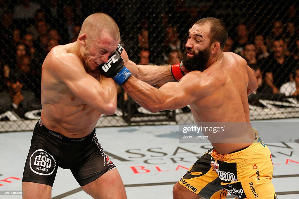 Johny Hendricks punches <a gi-track='captionPersonalityLinkClicked' href=/galleries/search?phrase=Georges+St-Pierre&family=editorial&specificpeople=4864241 ng-click='$event.stopPropagation()'>Georges St-Pierre</a> in their UFC welterweight championship bout during the UFC 167 event inside the MGM Grand Garden Arena on November 16, 2013 in Las Vegas, Nevada.