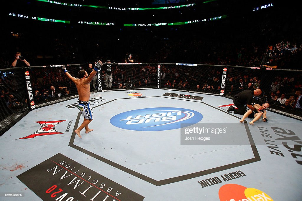 Johny Hendricks (L) reacts after knocking out Martin Kampmann with a left in the first round to win their welterweight bout during UFC 154 on November 17, 2012 at the Bell Centre in Montreal, Canada.