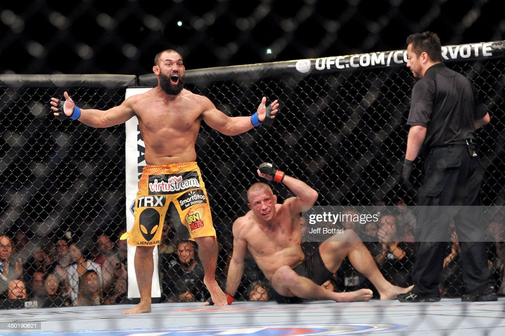 Johny Hendricks (L) reacts after the end of his fight with <a gi-track='captionPersonalityLinkClicked' href=/galleries/search?phrase=Georges+St-Pierre&family=editorial&specificpeople=4864241 ng-click='$event.stopPropagation()'>Georges St-Pierre</a> in their UFC welterweight championship bout during the UFC 167 event at the MGM Grand Garden Arena on November 16, 2013 in Las Vegas, Nevada.