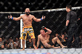 Johny Hendricks reacts after the end of his fight with Georges StPierre in their UFC welterweight championship bout during the UFC 167 event at the...