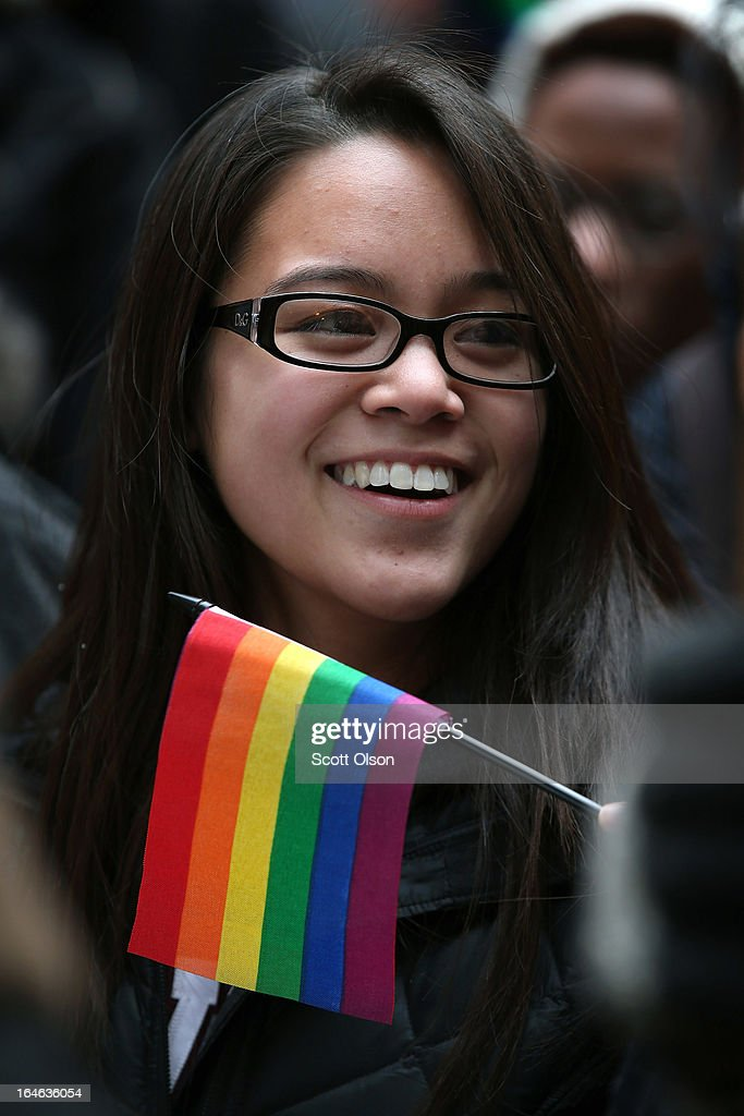 Joi Abarintos participates in a rally in support of gay marriage March 25, 2013 in Chicago, Illinois. The Supreme Court will hear arguments this week in two cases that could determine if states or the federal government can treat same-sex couples and those of the opposite sex differently when recognizing a marriage. The Illinois Senate has approved legislation that will legalize same-sex marriage in the state but it still has to be approved by the Illinois House and signed by Governor Pat Quinn, who has said he supports the legislation. If passed Illinois would become the tenth state to allow same-sex marriage. Thirty states have defined marriage as a union between a man and a woman.