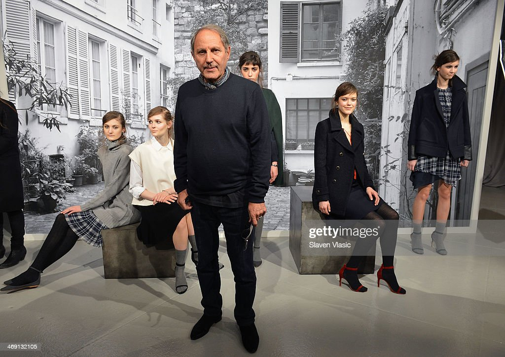 Joie's owner and creative director Serge Azria poses with models at the Joie presentation during Mercedes-Benz Fashion Week Fall 2014 at Center 548 on February 12, 2014 in New York City.