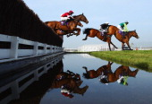 Join Together ridden by Ruby Walsh Cannington Brook ridden by Joe Tizzard and First Lieutenant ridden by Davy Russell clear the water jump in the RSA...