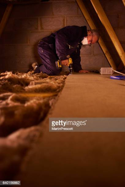 joiner laying attic floorboards