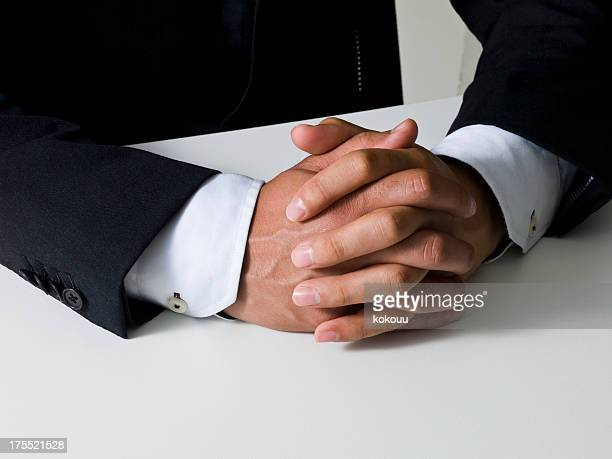 Joining of hands around the table