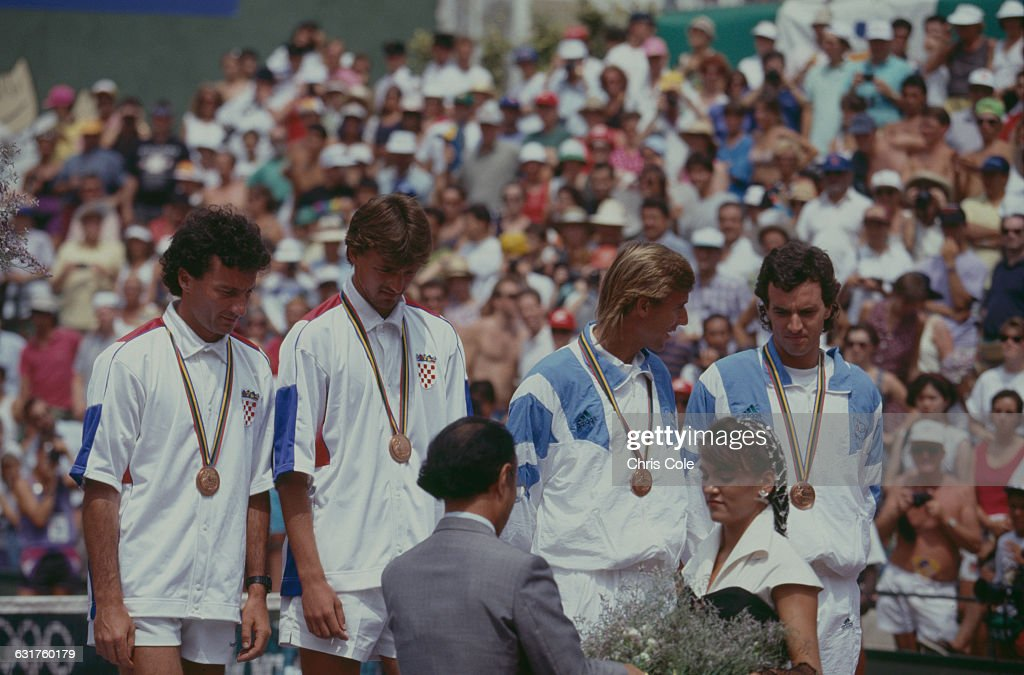 Joint bronze medalists in the tennis Men's Doubles receive their medals at the Vall d'Hebron complex on Montjuïc during the Olympic Games in...