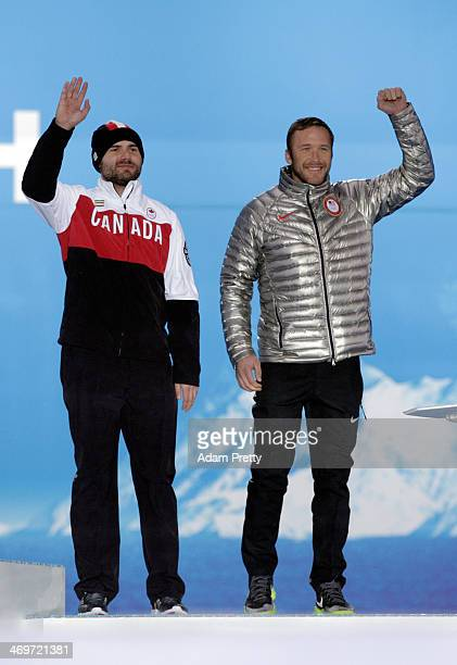 Joint bronze medalists Jan Hudec of Canada and Bode Miller of the United States celebrate on the podium during the medal ceremony for the Men's...