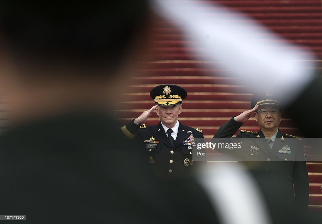 Joint Chiefs Chairman Gen. <a gi-track='captionPersonalityLinkClicked' href=/galleries/search?phrase=Martin+Dempsey&family=editorial&specificpeople=2116621 ng-click='$event.stopPropagation()'>Martin Dempsey</a> (L) and Chinese counterpart Gen. Fang Fenghui salute during a welcoming ceremony at the Bayi Building on April 22, 2013 in Beijing, China.