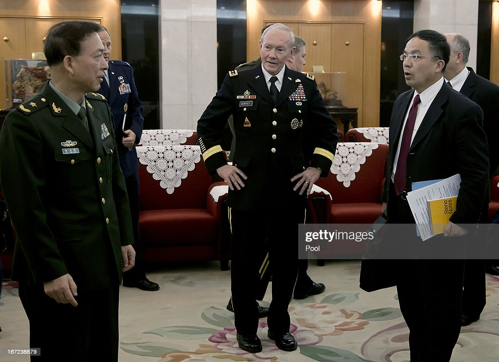 U.S. Joint Chiefs Chairman Gen. <a gi-track='captionPersonalityLinkClicked' href=/galleries/search?phrase=Martin+Dempsey&family=editorial&specificpeople=2116621 ng-click='$event.stopPropagation()'>Martin Dempsey</a> (C) arrives at the Bayi Building to meet with Chinese military officials April 23, 2013 in Beijing, China. Dempsey is on a weeklong series of engagements in China and Japan.