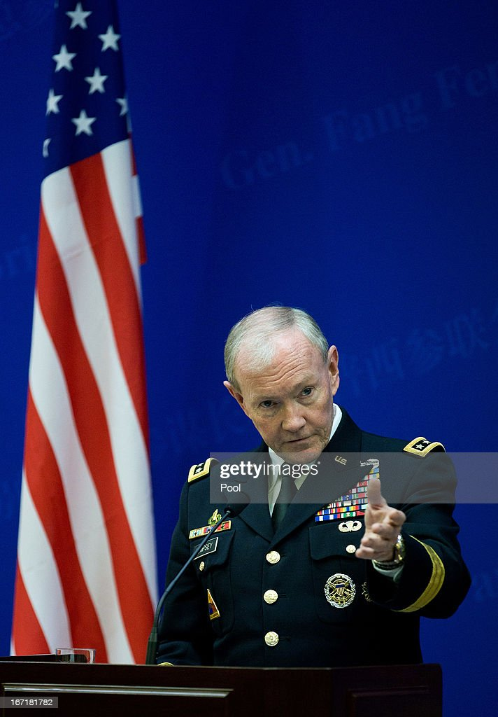 U.S. Joint Chiefs Chairman Gen. <a gi-track='captionPersonalityLinkClicked' href=/galleries/search?phrase=Martin+Dempsey&family=editorial&specificpeople=2116621 ng-click='$event.stopPropagation()'>Martin Dempsey</a> talks during a press briefing with Chinese couterpart Gen. Fang Fenghui at the Bayi Building on April 22, 2013 in Beijing, China. Dempsey is on a weeklong series of engagements in China and Japan.