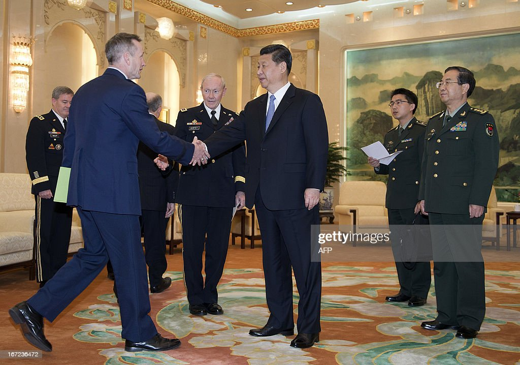 US Joint Chiefs Chairman General Martin Dempsey (2nd L) introduces a delegate to Chinese President Xi Jinping (C) as Chinese Chief of the General Staff Gen. Fang Fenghui (R) looks on before their meeting at the Great Hall of the People in Beijing on April 23, 2013. Dempsey was expected to discuss concerns over tensions with North Korea, amongst other bilateral items. AFP PHOTO / POOL / Andy Wong