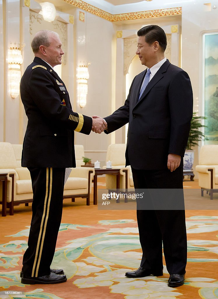 US Joint Chiefs Chairman General Martin Dempsey (L) shakes hands with Chinese President Xi Jinping before their meeting at the Great Hall of the People in Beijing on April 23, 2013. Dempsey was expected to discuss concerns over tensions with North Korea, amongst other bilateral items. AFP PHOTO / POOL / Andy Wong