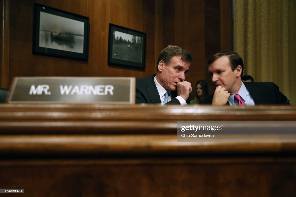 Joint Economic Committee members Sen. <a gi-track='captionPersonalityLinkClicked' href=/galleries/search?phrase=Mark+Warner&family=editorial&specificpeople=2251151 ng-click='$event.stopPropagation()'>Mark Warner</a> (D-VA) (L) and Sen. Christopher Murphy (D-CT) speak during a hearing about on fixing America's crumbling infrastructure on Capitol Hill July 24, 2013 in Washington, DC. The committee heard a variety of proposed solutions to the nation's serious infrastructure problems, including public-private partnership and increased government spending.