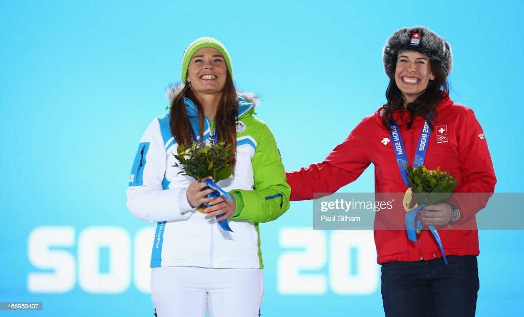 Joint gold medalists Tina Maze of Slovenia and Dominique Gisin of Switzerland celebrate during the medal ceremony for the for the Alpine Skiing...