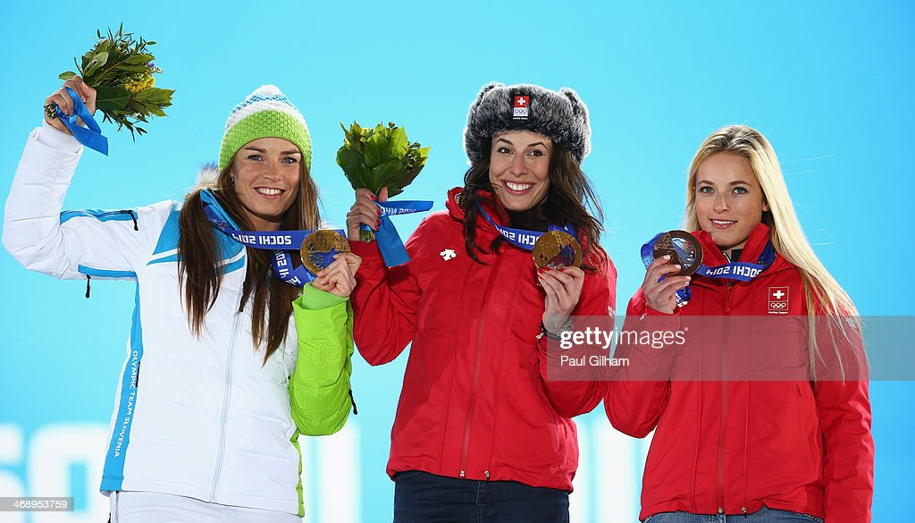 Joint gold medalists <a gi-track='captionPersonalityLinkClicked' href=/galleries/search?phrase=Tina+Maze&family=editorial&specificpeople=213514 ng-click='$event.stopPropagation()'>Tina Maze</a> of Slovenia and <a gi-track='captionPersonalityLinkClicked' href=/galleries/search?phrase=Dominique+Gisin&family=editorial&specificpeople=4083154 ng-click='$event.stopPropagation()'>Dominique Gisin</a> of Switzerland and bronze medalist <a gi-track='captionPersonalityLinkClicked' href=/galleries/search?phrase=Lara+Gut&family=editorial&specificpeople=4860592 ng-click='$event.stopPropagation()'>Lara Gut</a> of Switzerland celebrate during the medal ceremony for the for the Alpine Skiing Women's Downhill on day five of the Sochi 2014 Winter Olympics at Medals Plaza on February 12, 2014 in Sochi, Russia.