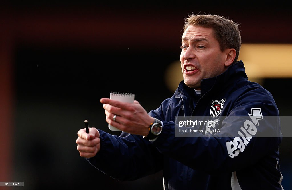 Joint manager Rob Scott of Grimsby gestures during the FA Trophy semi final match between Grimsby Town v Dartford at Blundell Park on February 16, 2013 in Grimsby, England.