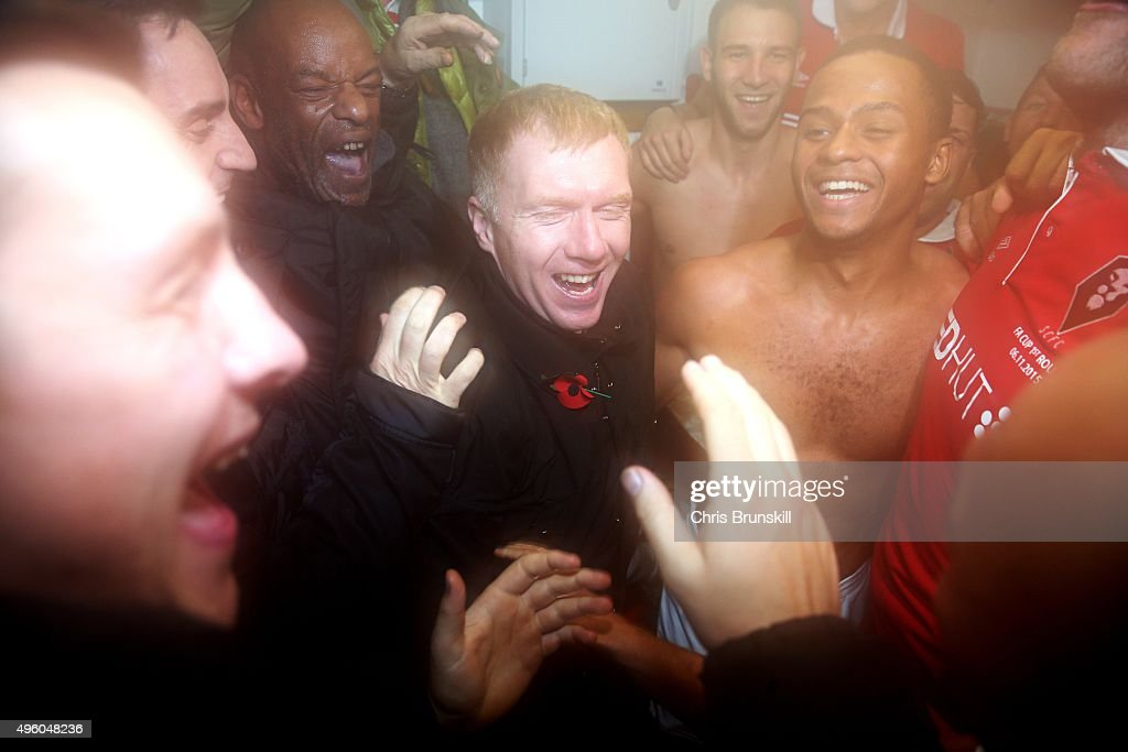 Joint Salford City owner Paul Scholes (C) celebrates victory in the changing room after the Emirates FA Cup first round match between Salford City and Notts County at Moor Lane on November 6, 2015 in Salford, England