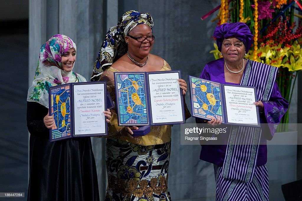 Joint winners Yemeni journalist and activist Tawakul Karman, Liberian activist Leymah Gbowee and Liberian President <a gi-track='captionPersonalityLinkClicked' href=/galleries/search?phrase=Ellen+Johnson+Sirleaf&family=editorial&specificpeople=547358 ng-click='$event.stopPropagation()'>Ellen Johnson Sirleaf</a> hold up their prizes at the Nobel Peace Prize Award Ceremony at Oslo City Hall on December 10, 2011 in Oslo, Norway.