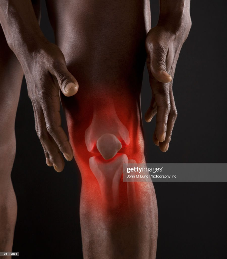 Joints of mixed race man's knee : Stock Photo