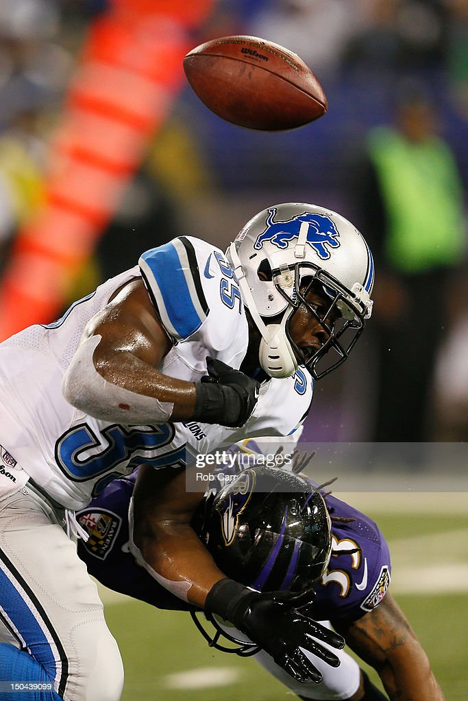 <a gi-track='captionPersonalityLinkClicked' href=/galleries/search?phrase=Joique+Bell&family=editorial&specificpeople=6780199 ng-click='$event.stopPropagation()'>Joique Bell</a> #35 of the Detroit Lions fumbles the ball while being tackled by Christian Thompson #33 of the Baltimore Ravens during the second half at M&T Bank Stadium on August 17, 2012 in Baltimore, Maryland.