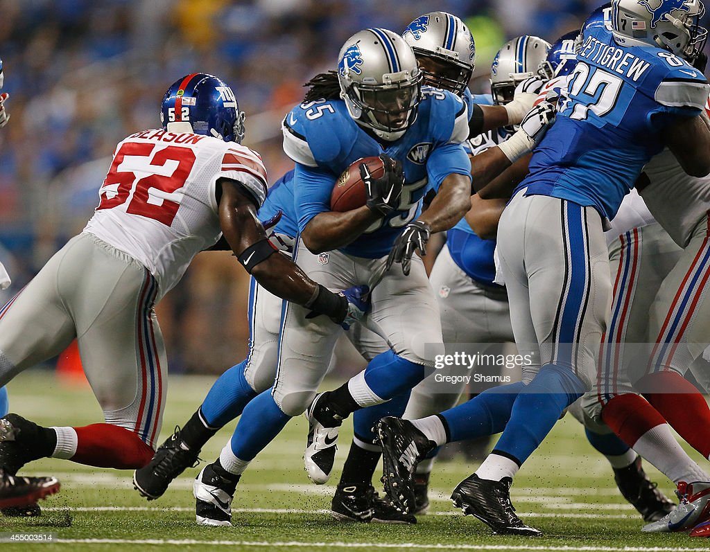 <a gi-track='captionPersonalityLinkClicked' href=/galleries/search?phrase=Joique+Bell&family=editorial&specificpeople=6780199 ng-click='$event.stopPropagation()'>Joique Bell</a> #35 of the Detroit Lions tries to avoid the tackle by <a gi-track='captionPersonalityLinkClicked' href=/galleries/search?phrase=Jon+Beason&family=editorial&specificpeople=2109827 ng-click='$event.stopPropagation()'>Jon Beason</a> #52 of the New York Giants in a third quarter run at Ford Field on September 8, 2014 in Detroit, Michigan.