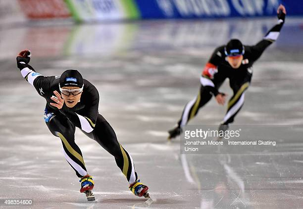 Joji Kato competes against Ryohei Haga in the Men's 500m race during the race on day three of the ISU World Cup Speed Skating Salt Lake City Event at...