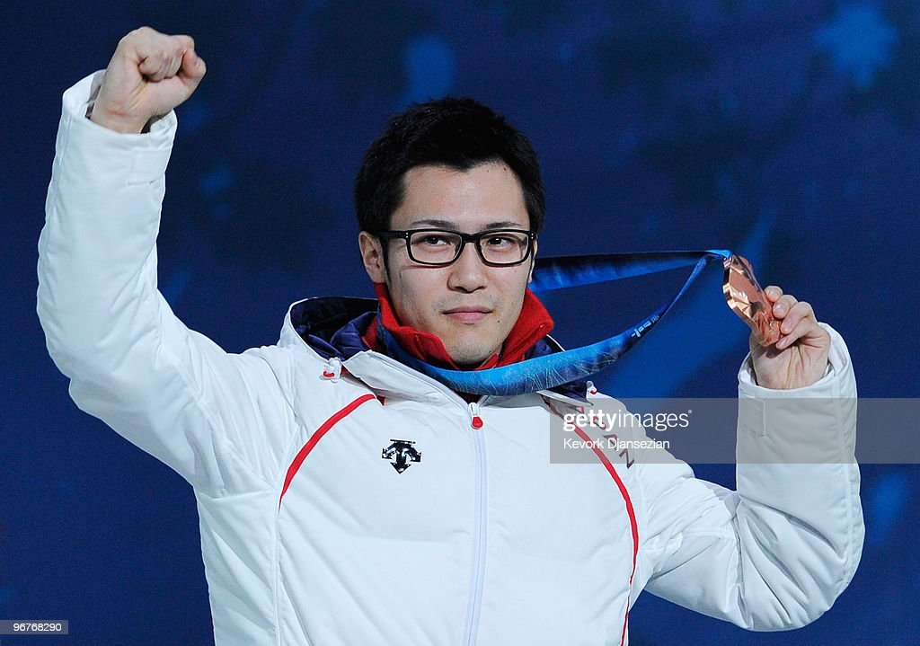 Joji Kato of Japan celebrates winning the bronze medal during the medal cermony for the Men's 500m Speed Skating on day 5 of the Vancouver 2010 Winter Olympics at BC Place on February 16, 2010 in Vancouver, Canada.