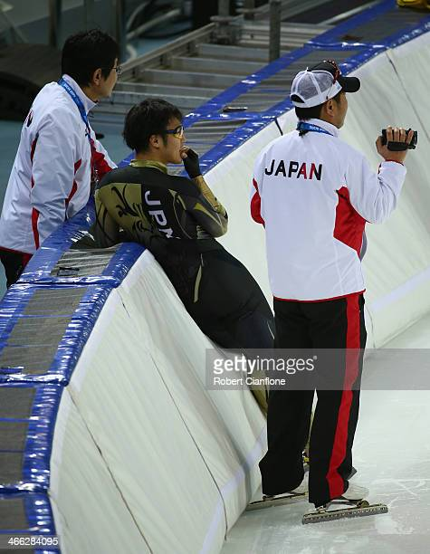 Joji Kato of Japan looks on during a training session ahead of the Sochi 2014 Winter Olympics at Adler Arena Skating Center on February 1 2014 in...