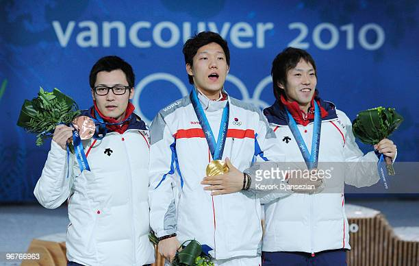 Joji Kato of Japan poses for a photo as he celebrates winning the bronze medal Mo TaeBum of South Korea gold and Keiichiro Nagashima of Japan silver...