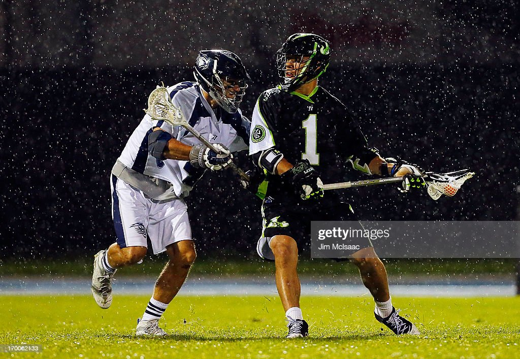 JoJo Marasco of the New York Lizards controls the ball against Dan Burns of the Chesapeake Bayhawks during their Major League Lacrosse game at Icahn...