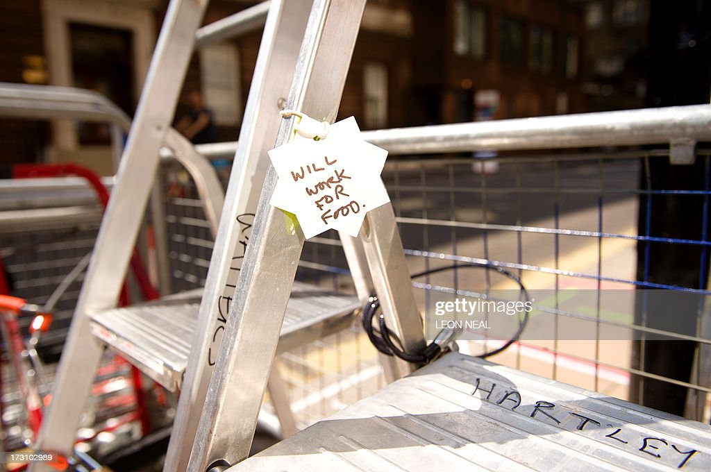 Joke tags written by bored media crews are shown hanging from the stepladders outside the Lindo Wing of St Mary's hospital in London on July 7, 2013. Prince William and wife Catherine's first child is not officially due until mid-July but this hasn't stopped news organisations from setting up dozens of camera positions outside the private Lindo Wing of St Mary's Hospital, where William was born in 1982 and his brother Harry in 1984.