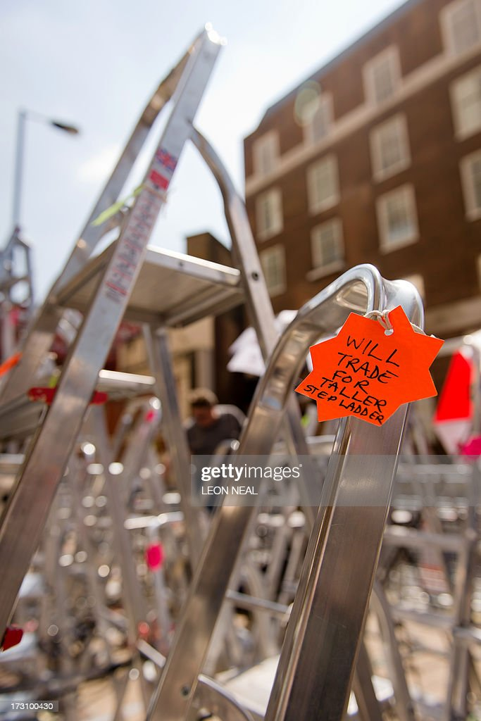 Joke tags written by media crews are shown hanging from the stepladders outside the Lindo Wing of St Mary's hospital in London on July 7, 2013. Prince William and wife Catherine's first child is not officially due until mid-July but this hasn't stopped news organisations from setting up dozens of camera positions outside the private Lindo Wing of St Mary's Hospital, where William was born in 1982 and his brother Harry in 1984.