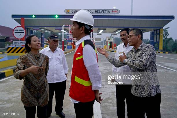 Joko Widodo Indonesia's president center is briefed by Rini Soemarno Indonesia's minister of stateowned enterprises from left Basuki Hadimuljono...