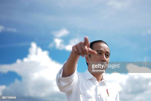 Joko Widodo Indonesia's president gestures ahead of a Bloomberg Television interview in Silangit North Sumatra Indonesia on Saturday Oct 14 2017...