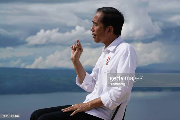 Joko Widodo Indonesia's president gestures as he speaks during a Bloomberg Television interview in Silangit North Sumatra Indonesia on Saturday Oct...