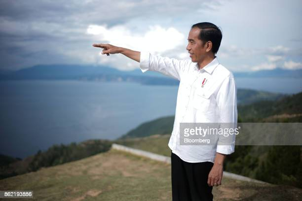 Joko Widodo Indonesia's president gestures in front of Lake Toba ahead of a Bloomberg Television interview in Silangit North Sumatra Indonesia on...