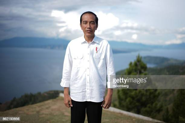 Joko Widodo Indonesia's president poses for a photograph in front of Lake Toba ahead of a Bloomberg Television interview in Silangit North Sumatra...