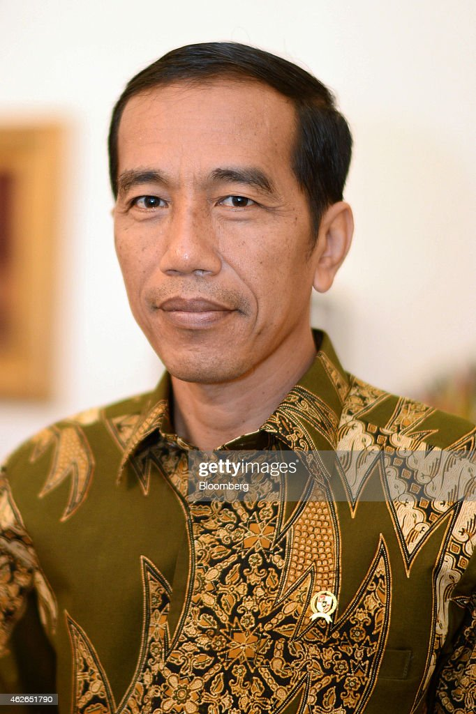 <a gi-track='captionPersonalityLinkClicked' href=/galleries/search?phrase=Joko+Widodo&family=editorial&specificpeople=6657368 ng-click='$event.stopPropagation()'>Joko Widodo</a>, Indonesia's president, poses for a photograph in his office at Istana Merdeka, the president's official residence, in Jakarta, Indonesia, on Monday, Feb. 2, 2015. Widodo will decide this week whether to install as police chief a three-star general who faces a corruption probe, as he seeks to end an episode that put his graft-fighting credentials in question. Photographer: Dimas Ardian/Bloomberg via Getty Images