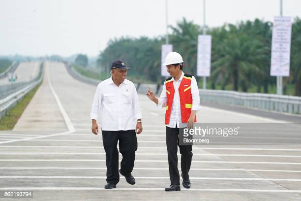 Joko Widodo Indonesia's president right speaks with Basuki Hadimuljono Indonesia's minister of public works and housing during the inauguration of...