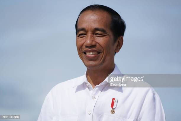 Joko Widodo Indonesia's president smiles during a Bloomberg Television interview in Silangit North Sumatra Indonesia on Saturday Oct 14 2017...